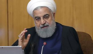 In this photo released by the official website of the office of the Iranian Presidency, President Hassan Rouhani speaks in a Cabinet meeting in Tehran, Iran, Wednesday, May 8, 2019. Rouhani said Wednesday that it will begin keeping its excess uranium and heavy water from its nuclear program, setting a 60-day deadline for new terms to its nuclear deal with world powers before it will resume higher uranium enrichment. (Iranian Presidency Office via AP)