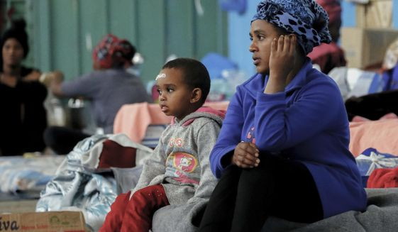 Migrants who fled fighting gather at a detention center in Zawya, Libya, west of Tripoli, on Saturday, April 27, 2019. Humanitarian organizations and international institutions are concerned about the situation of thousands of migrants in Libya caught between forces loyal to the U.N.-supported government in Tripoli and the government in the east, which Field Marshal Khalifa Hifter is aligned with. (AP Photo/Hazem Ahmed)