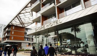"""This Monday, May 6, 2019 photo shows the exterior of the Shore Hotel in Santa Monica, Calif. The California Coastal Commission is fining the hotel's developer $15 million for building the high-priced hotel near the Santa Monica Pier after obtaining a permit for a property with moderately priced rooms. Officials say Sunshine Enterprises perpetrated a """"bait and switch"""" while violating the state's landmark Coastal Act, which enshrines public access to beach areas.  (AP Photo/Jae C. Hong)"""
