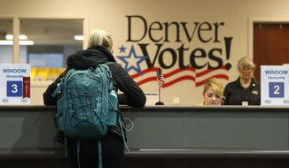 "A voter fills out her ballot at the Denver Elections Division Tuesday, May 7, 2019, in Denver. Voters could make Denver the first U.S. city to decriminalize the use of psilocybin, the psychoactive substance in ""magic mushrooms"" if the measure passes. (AP Photo/David Zalubowski)"
