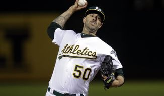 Oakland Athletics pitcher Mike Fiers works against the Cincinnati Reds during the first inning of a baseball game Tuesday, May 7, 2019, in Oakland, Calif. (AP Photo/Ben Margot)