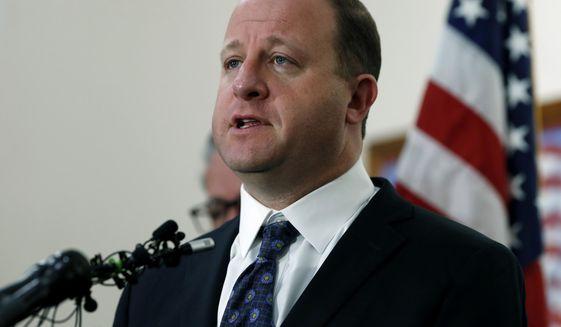 Colorado Gov. Jared Polis is shown in a May 8, 2019 press conference in this file photo. (AP Photo/David Zalubowski) **FILE**