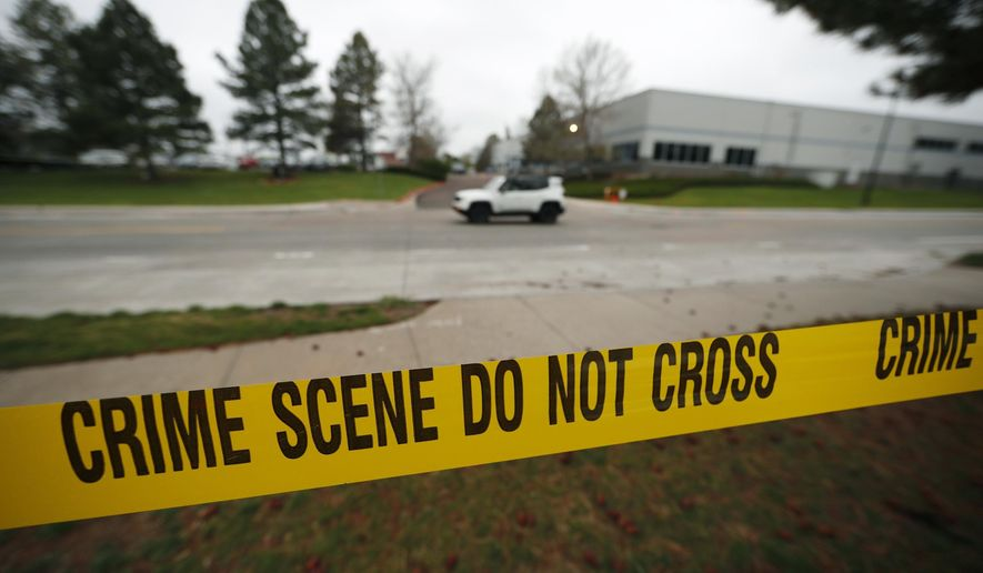 Police tape remains near the scene following Tuesday's shooting at STEM Highlands Ranch school, Wednesday, May 8, 2019, in Highlands Ranch, Colo. (AP Photo/David Zalubowski) ** FILE **