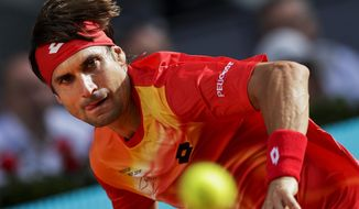 David Ferrer, from Spain, returns the ball to Roberto Bautista, from Spain, during the Madrid Open tennis tournament in Madrid, Tuesday, May 7, 2019. (AP Photo/Bernat Armangue)