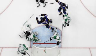 St. Louis Blues' Pat Maroon (7) and Robert Thomas (18) celebrate a score by Maroon, as Dallas Stars' John Klingberg (3), Ben Bishop (30), Miro Heiskanen (4) and Justin Dowling (37) react during the second overtime in Game 7 of an NHL second-round hockey playoff series Tuesday, May 7, 2019, in St. Louis. The Blues won 2-1. (AP Photo/Jeff Roberson) ** FILE **