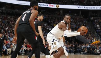 Denver Nuggets forward Paul Millsap, right, looks to shoot the ball as Portland Trail Blazers forward Maurice Harkless defends in the first half of Game 5 of an NBA basketball second-round playoff series, Tuesday, May 7, 2019, in Denver. (AP Photo/David Zalubowski)