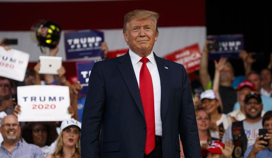 President Donald Trump arrives to speak at a rally at Aaron Bessant Amphitheater, Wednesday, May 8, 2019, in Panama City Beach, Fla. (AP Photo/Evan Vucci)