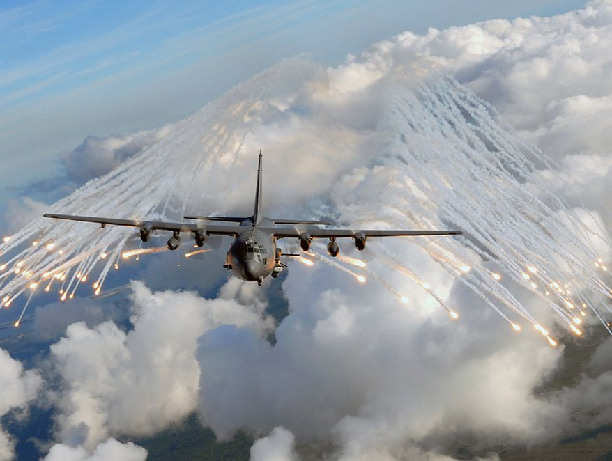 An AC-130U gunship from the 4th Special Operations Squadron, jettisons flares over an area near Hurlburt Field, Fla., Aug. 20, 2008. The flares are a countermeasure for heat-seeking missiles that may be launched at the aircraft during real world missions. (U.S. Air Force photo by Senior Airman Julianne Showalter)