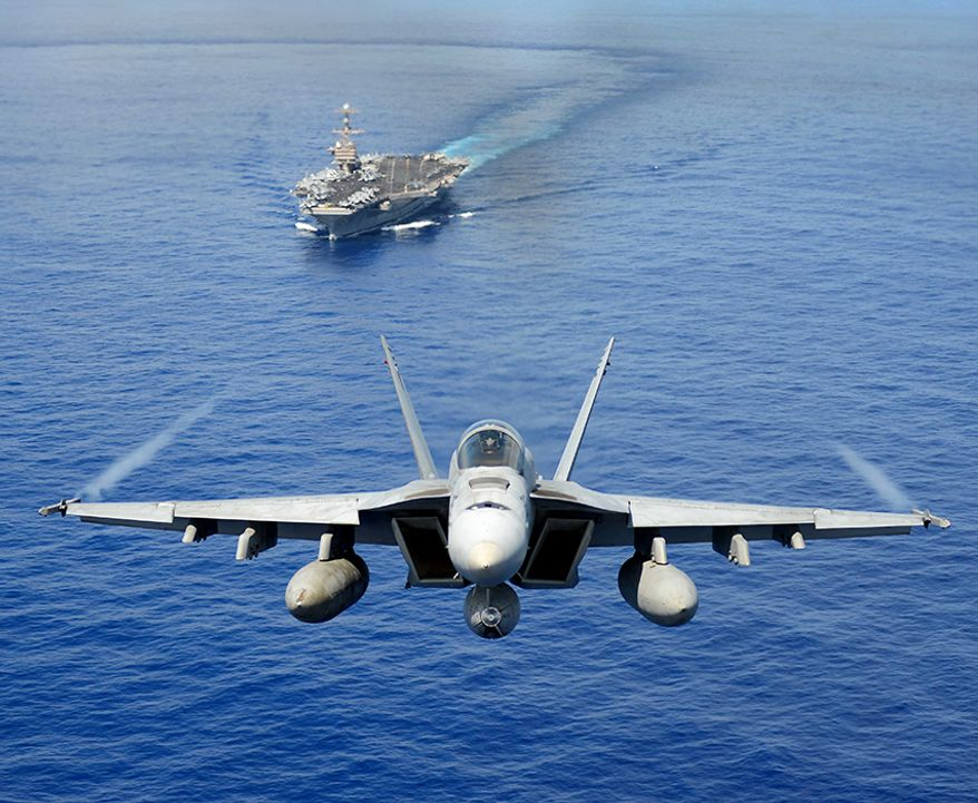 An F/A-18E Super Hornet from the Tophatters of Strike Fighter Squadron (VFA) 14 participates in an air power demonstration over the aircraft carrier USS John C. Stennis (CVN 74). The John C. Stennis Carrier Strike Group is returning from an eight-month deployment to the U.S. 5th and 7th Fleet areas of responsibility. (U.S. Navy Photo by Mass Communication Specialist Seaman Apprentice Ignacio D. Perez/Released)