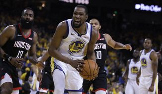 Houston Rockets' James Harden, left, and Golden State Warriors' Kevin Durant (35) react to a referee's call during the second half of Game 5 of a second-round NBA basketball playoff series Wednesday, May 8, 2019, in Oakland, Calif. (AP Photo/Ben Margot) **FILE**