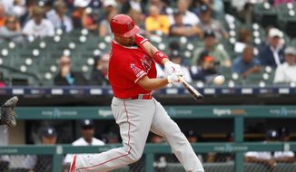 Los Angeles Angels' Albert Pujols hits a solo home run in the third inning of a baseball game against the Detroit Tigers in Detroit, Thursday, May 9, 2019. The home run was his 2,000th career RBI. (AP Photo/Paul Sancya) **FILE**