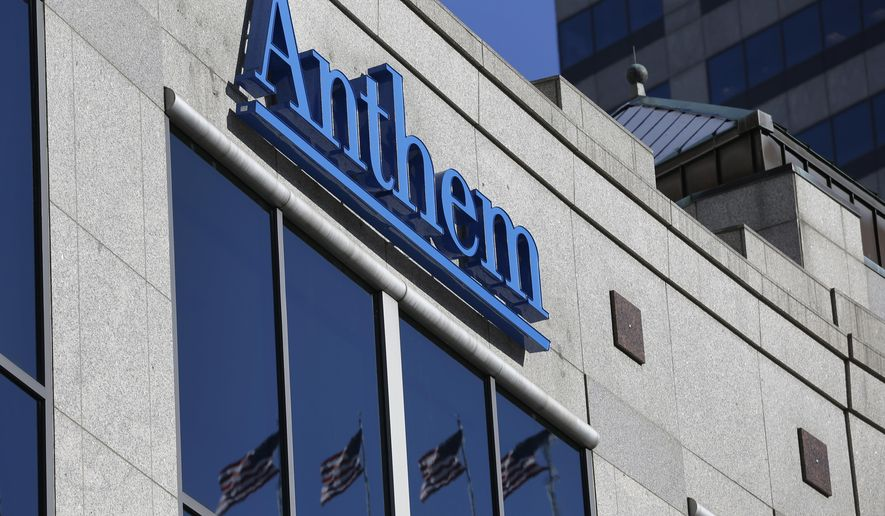 FILE - This Feb. 5, 2015, file photo shows the Anthem logo at the health insurer's corporate headquarters in Indianapolis. The Justice Department says a grand jury has indicted Fujie Wang and another Chinese man identified only as John Doe for hacking into the computers of health insurer Anthem Inc. and three other, unnamed companies, in an indictment unsealed Thursday, May 9, 2019, in Indianapolis. (AP Photo/Michael Conroy, File)