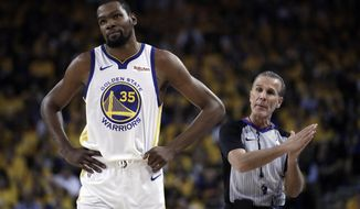 Golden State Warriors' Kevin Durant, left, walks away from referee Ken Mauer during the first half of Game 5 of the team's second-round NBA basketball playoff series against the Houston Rockets on  Wednesday, May 8, 2019, in Oakland, Calif. (AP Photo/Ben Margot)