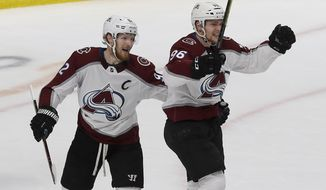 Colorado Avalanche right wing Mikko Rantanen, right, celebrates with left wing Gabriel Landeskog after scoring a goal against the San Jose Sharks during the first period of Game 7 of an NHL hockey second-round playoff series in San Jose, Calif., Wednesday, May 8, 2019. (AP Photo/Jeff Chiu)
