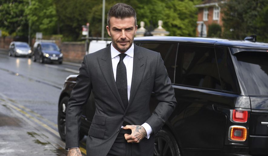 Football star David Beckham arrives at Bromley Magistrates Court for a hearing after he was spotted using his mobile phone while driving his Bentley, in London, Thursday, May 9, 2019. The magistrate has the power to impose six penalty points and a £200 fine for the charge of using a mobile while driving. (Victoria Jones/PA via AP)