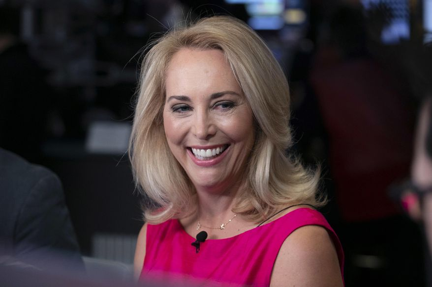 In this Oct. 22, 2018, file photo, former CIA operative Valerie Plame is interviewed on the floor of the New York Stock Exchange. Plame has decided to run for the Democratic nomination to an open congressional seat in New Mexico. Plame told The Associated Press on Thursday, May 9, 2019, that she wants to give back to a community that welcomed her after leaving Washington in 2007. (AP Photo/Richard Drew, File)