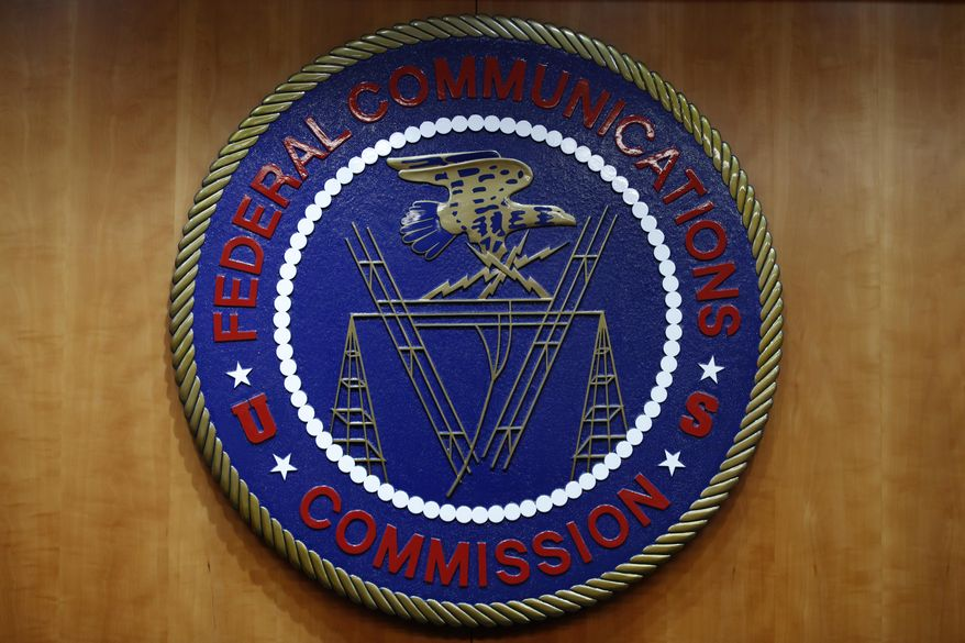 In this Dec. 14, 2017, file photo, the seal of the Federal Communications Commission (FCC) is seen before an FCC meeting to vote on net neutrality in Washington. U.S. On Dec. 8, 2020, Nathan Simington, a Trump nominee to the commission, was confirmed by the Senate. (AP Photo/Jacquelyn Martin, File)  **FILE**