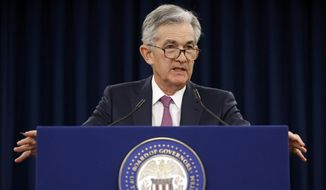 FILE - In this May 1, 2019, file photo Federal Reserve Board Chair Jerome Powell speaks at a news conference following a two-day meeting of the Federal Open Market Committee in Washington. Powell says the United States needs to find ways to address a decades-long slowdown in income growth and upward economic mobility. (AP Photo/Patrick Semansky, File)