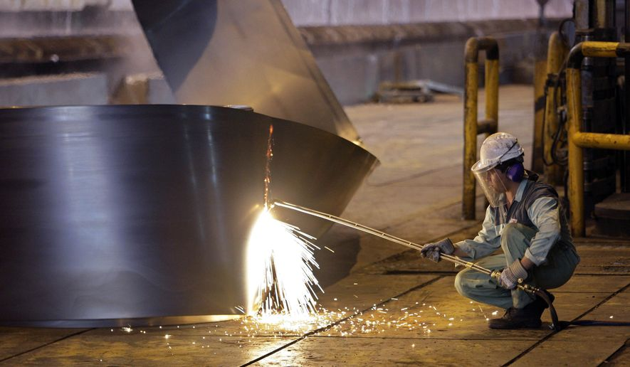 FILE - In this May 31, 2012 file photo, an Iranian worker cuts a steel roll at the Mobarakeh Steel Complex, some 280 miles (460 kilometers) south of the capital Tehran, and some 40 miles, 65 kilometers, southwest of central Iranian city of Isfahan. President Donald Trump ordered new sanctions on Iran Wednesday targeting Iran's steel, aluminum, copper and iron sectors, which provide foreign currency earnings for the nation's sagging economy. (AP Photo/Vahid Salemi, File)
