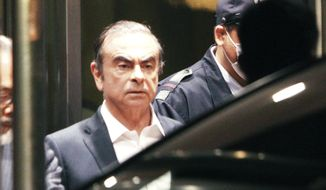 In this April 25, 2019, former Nissan Chairman Carlos Ghosn leaves the Tokyo Detention Center in Tokyo. A Japanese court has turned down an appeal from the lawyers of Ghosn over his bail conditions that limit his contact with his wife. Kyodo News service reported Thursday the Tokyo District Court rejected the appeal filed earlier in the day. (AP Photo/Eugene Hoshiko, File) **FILE**