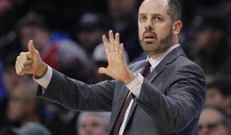 FILE - In this Nov. 25, 2017, file photo, Orlando Magic coach Frank Vogel signals from the sideline during the first half of the team's NBA basketball game against the Philadelphia 76ers in Philadelphia. A person familiar with the search says Vogel will be interviewed for the Lakers head coach opening. The 45-year old Vogel did not coach last season following two years with the Orlando Magic.(AP Photo/Laurence Kesterson, File)