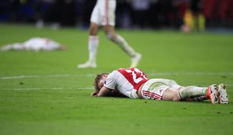 Ajax's Frenkie de Jong lies on the pitch at the end of the Champions League semifinal second leg soccer match between Ajax and Tottenham Hotspur at the Johan Cruyff ArenA in Amsterdam, Netherlands, Wednesday, May 8, 2019. (AP Photo/Peter Dejong)