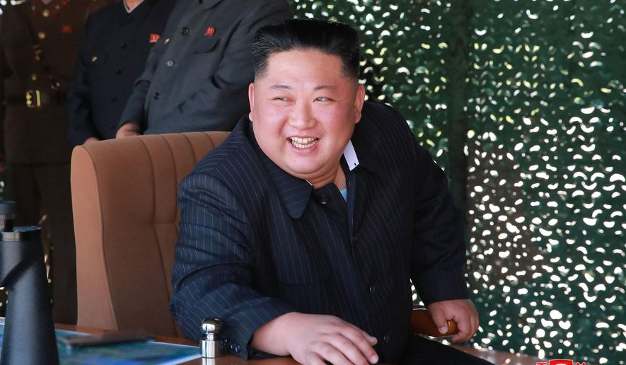 "This Thursday, May 9, 2019, photo provided Friday, May 10, by the North Korean government shows North Korean leader Kim Jong Un, observing a military test in North Korea. North Korea fired two suspected short-range missiles toward the sea on Thursday, South Korean officials said, its second weapons launch in five days and a possible warning that nuclear disarmament talks with Washington could be in danger. Independent journalists were not given access to cover the event depicted in this image distributed by the North Korean government. The content of this image is as provided and cannot be independently verified. Korean language watermark on image as provided by source reads: ""KCNA"" which is the abbreviation for Korean Central News Agency. (Korean Central News Agency/Korea News Service via AP)"