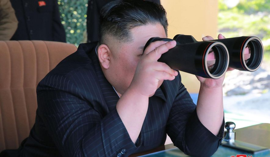 "This Thursday, May 9, 2019, photo provided Friday, May 10, 2019, by the North Korean government shows North Korean leader Kim Jong Un, observing a military test in North Korea. North Korea fired two suspected short-range missiles toward the sea on Thursday, South Korean officials said, its second weapons launch in five days and a possible warning that nuclear disarmament talks with Washington could be in danger. Independent journalists were not given access to cover the event depicted in this image distributed by the North Korean government. The content of this image is as provided and cannot be independently verified. Korean language watermark on image as provided by source reads: ""KCNA"" which is the abbreviation for Korean Central News Agency. (Korean Central News Agency/Korea News Service via AP)"