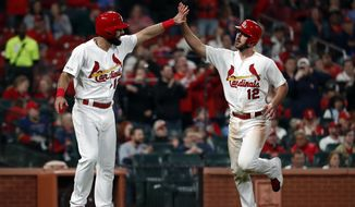 St. Louis Cardinals' Matt Carpenter and Paul DeJong (12) celebrate after scoring on a three-run double by Marcell Ozuna during the sixth inning of a baseball game against the Pittsburgh Pirates on Thursday, May 9, 2019, in St. Louis. (AP Photo/Jeff Roberson)