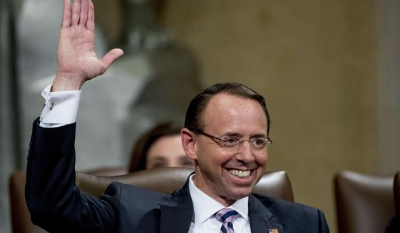Deputy Attorney General Rod Rosenstein reacts to a speaker as he is honored with a farewell ceremony in the Great Hall at the Department of Justice in Washington, Thursday, May 9, 2019. Rosenstein is set to step down as Deputy Attorney General May 15th. (AP Photo/Andrew Harnik)