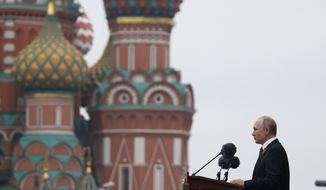 Russian President Vladimir Putin speaks during the Victory Day military parade marking 74 years since the victory in WWII in Red Square in Moscow, Russia, Thursday, May 9, 2019. (AP Photo/Alexander Zemlianichenko)