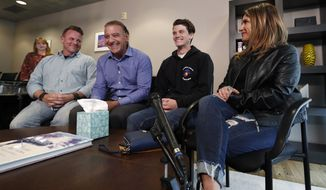 Brendan Bialy, third from left, joins mother Dena Martin, right, father Brad Bialy, far left, and attorney Mark Bryant to speak about his role in stopping the attack at the STEM School Highlands Ranch during a news conference Wednesday, May 8, 2019, in Englewood, Colo. Eighteen-year-old Bialy said he, Kendrick Castillo and a third student tried to stop the gunman by charging at him during Tuesday's attack at the STEM School Highlands Ranch. (AP Photo/David Zalubowski)