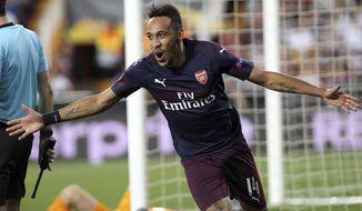 Arsenal forward Pierre-Emerick Aubameyang celebrates after scoring his side's third goal during the Europa League semifinal soccer match, second leg, between Valencia and Arsenal at the Camp de Mestalla stadium in Valencia, Spain, Thursday, May 9, 2019. (AP Photo/Alberto Saiz)