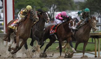 "In this May 4, 2019, file photo, Flavien Prat on Country House, left, races against Luis Saez on Maximum Security, second from right, during the 145th running of the Kentucky Derby horse race at Churchill Downs in Louisville, Ky. Replay clearly shows the horse that finished first in the Kentucky Derby, Maximum Security, veering into the path of others. A 22-minute ""inquiry"" into the matter resulted in Maximum Security's disqualification. Horse racing, the sport that practically invented the use of instant replay to adjudicate results on the track (the photo finish dates back to the 1930s), had been bitten by the technology it helped create. (AP Photo/John Minchillo, File) **FILE**"