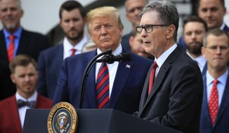 President Donald Trump listens as Red Sox owner John Henry speaks during a ceremony welcoming the 2018 World Series baseball champions to the White House, Thursday, May 9, 2019, Washington. (AP Photo/Manuel Balce Ceneta)