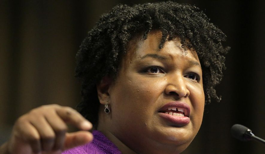 In this April 3, 2019, file photo, former Georgia gubernatorial candidate Stacey Abrams speaks during the National Action Network Convention in New York. (AP Photo/Seth Wenig) ** FILE **