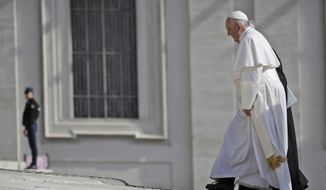 Pope Francis walks towards St. Peter's Basilica at the start of for his weekly general audience, in St. Peter's Square, at the Vatican, Wednesday, May 8, 2019. (AP Photo/Alessandra Tarantino)
