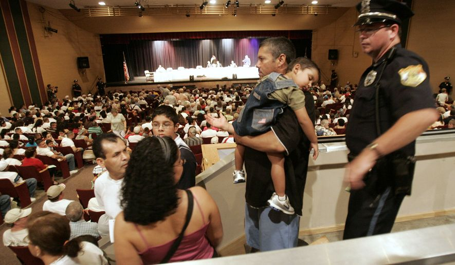 Hundreds crowd into the Fremont High School auditorium on Tuesday, July 29, 2008, in Fremont, Neb., to attend a public hearing on a plan that would outlaw renting housing to or hiring illegal immigrants in this city of 25,000.  (AP Photo/Nati Harnik)
