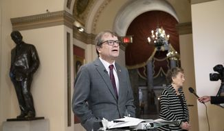 Illinois Democrats, Rep. Mike Quigley, left, and Rep. Jan Schakowsky, do TV news interviews before votes in the House, on Capitol Hill in Washington, Friday, May 10, 2019. (AP Photo/J. Scott Applewhite) **FILE**