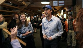 Democratic presidential candidate and former Texas Congressman Beto O'Rourke smiles as he arrives with his wife Amy for a campaign stop at Colby-Sawyer College in New London, N.H., Friday, May 10, 2019. (AP Photo/Charles Krupa)