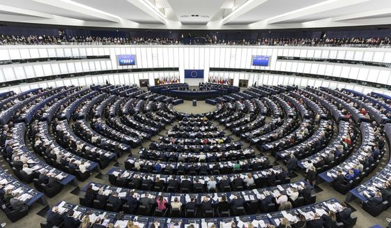 This March 27, 2019, file photo, shows the European Parliament during a plenary session in Strasbourg, eastern France. The Parliament discusses the conclusions of the 21-22 March EU summit, including Brexit, with European Council President Donald Tusk and Commission President Jean-Claude Juncker. (AP Photo/Jean-Francois Badias, File)