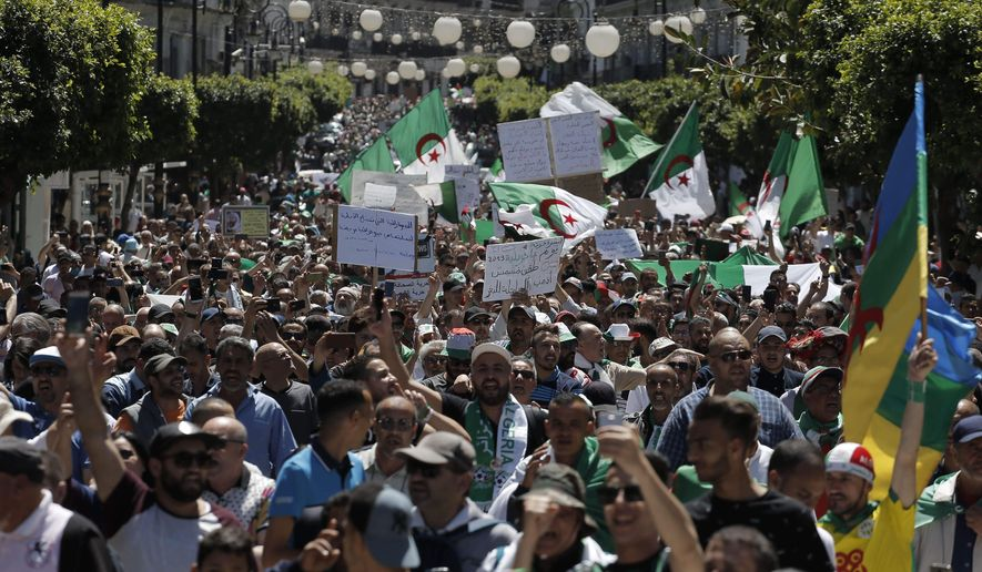 Algerian protesters march with national flags during an anti-government demonstration in the capital Algiers on Friday, May 10, 2019. Protesters thronged the center of Algiers on May 10 for their 12th weekly mass rally, the first since the start of the Islamic fasting month of Ramadan. (AP Photo/Anis Belghoul)