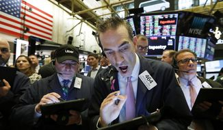 Stock trader Gregory Rowe works at the New York Stock Exchange, Friday, May 10, 2019. (AP Photo/Richard Drew)