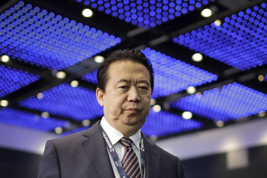 FILE - In this July 4, 2017, file photo, Interpol President, Meng Hongwei, walks toward the stage to deliver his opening address at the Interpol World Congress in Singapore. Chinese prosecutors on Friday, May 10, 2018, indicted former Interpol president Meng Hongwei on charges of accepting bribes, the latest development in a case that began with his disappearance while on a journey to Beijing. (AP Photo/Wong Maye-E, File)