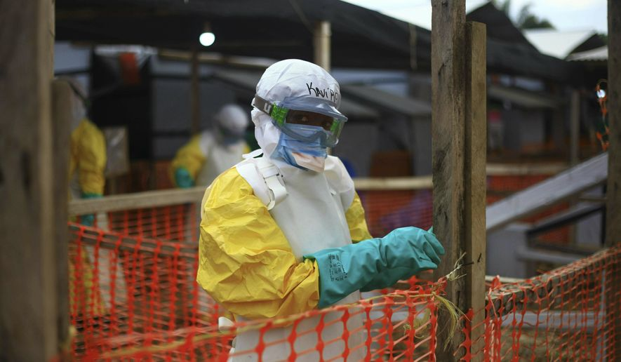 In this Tuesday, April, 16, 2019, file photo, an Ebola health worker is seen at a treatment center in Beni, Eastern Congo. (AP Photo/Al-hadji Kudra Maliro, file)