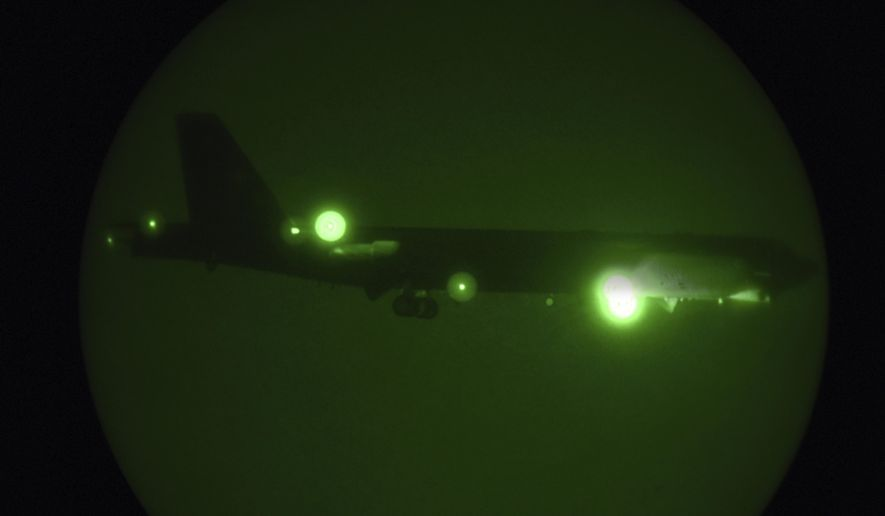 In this Thursday, May 9, 2019, photo released by the U.S. Air Force, a B-52H Stratofortress assigned to the 20th Expeditionary Bomb Squadron is seen through night vision coming in for a landing at Al Udeid Air Base, Qatar. The B-52 bombers ordered by the White House to deploy to the Persian Gulf to counter unspecified threats from Iran are beginning to arrive at a major American air base in Qatar. (Staff Sgt. Ashley Gardner/U.S. Air Force via AP)