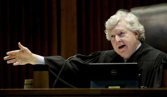 FILE--In this May 9, 2019, file photo, Kansas Supreme Court Justice Dan Biles asks a question during oral arguments in a court of appeals nomination disagreement in Topeka, Kan. A Kansas Supreme Court ruling Friday, written by Biles, will force the state Senate to vote to reject a nominee for a lower-court judgeship if senators want to keep him off the bench because of his political tweets. The Supreme Court ruled unanimously that Gov. Laura Kelly did not have the authority to withdraw her nomination of Labette County District Judge Jeffry Jack for the state Court of Appeals. Kelly dropped Jack's nomination after political posts on his Twitter feed in 2017 came to light. Kelly chose a second nominee, but Senate President Susan Wagle argued that the appointment went to Kansas Supreme Court Chief Justice Lawton Nuss. (AP Photo/Charlie Riedel, File)