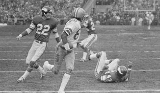 "FILe - In this Dec. 28, 1975, file photo Dallas Cowboys wide receiver Drew Pearson (88) nears the end zone with the game-winning 50-yard touchdown pass late in the fourth quarter as the Cowboys defeated the Minnesota Vikings in the NFC playoff NFL football game in Bloomington, Minn. Hail Mary: Credit Hall of Famer Roger Staubach with this. After the Cowboys quarterback completed a late 50-yard pass to Pearson to win a playoff game at Minnesota, Staubach said: ""I guess you could call it a Hail Mary. You throw it up and pray."" (AP Photo/File)"
