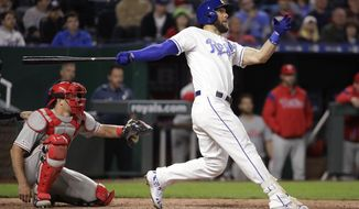 Kansas City Royals' Alex Gordon watches his solo home run during the fifth inning of the team's baseball game against the Philadelphia Phillies on Friday, May 10, 2019, in Kansas City, Mo. The homer was Gordon's 1,500th career hit. (AP Photo/Charlie Riedel)