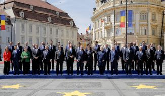 European Union leaders pose for a group photo at an EU summit in Sibiu, Romania, Thursday, May 9, 2019. European Union leaders on Thursday start to set out a course for increased political cooperation in the wake of the impending departure of the United Kingdom from the bloc. (AP Photo/Vadim Ghirda)